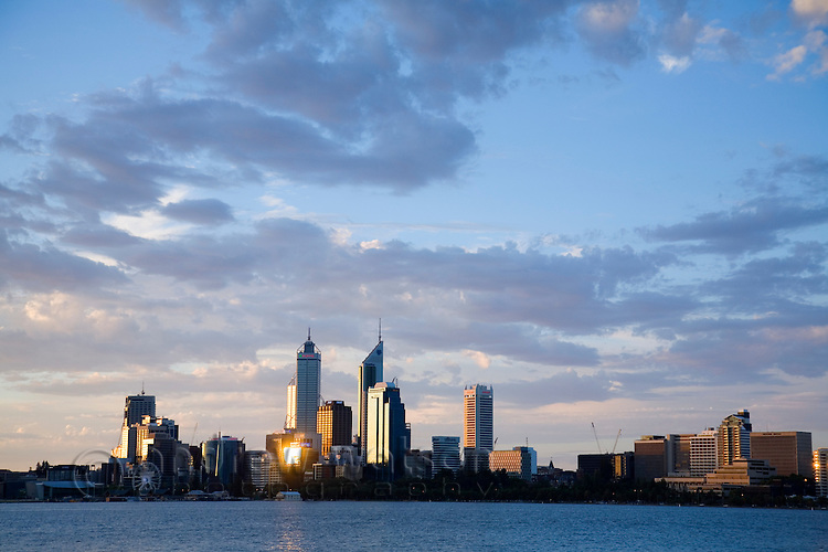 View across the Swan River to the city skyline at dusk.  Perth, Western Australia, AUSTRALIA.