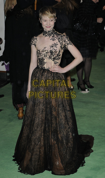 MIA WASIKOWSKA.Royal World Film Premiere of 'Alice in Wonderland' at the Odeon Cinema, Leicester Square, London, England..February 25th, 2010 .arrivals full length hand on hip maxi gown layered skirt polo high neck black cream beige lace dress bustier sheer see through thru .CAP/CAN.©Can Nguyen/Capital Pictures.