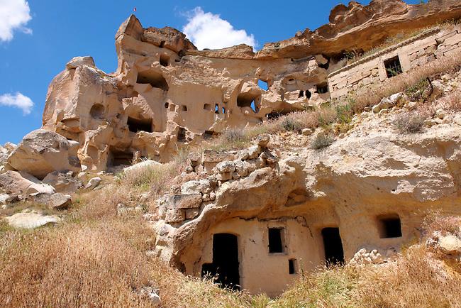 Troglodyte cave houses in tuff volcanic rock, Cappadocia, Anatolia, Turkey