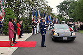 United States President Barack Obama and First Lady Michelle Obama prepare to greet President Felipe Calderón of Mexico and his wife, Mrs. Margarita Zavala, as their limousine approaches the South Portico entrance of the White House, Wednesday, May 19, 2010. .Mandatory Credit: Pete Souza - White House via CNP