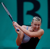 Maria Sharapova (RUS) (12) against Ksenia Pervak (RUS) in the first round of the women's singles. Maria Sharapova beat Ksenia Pervak 6-3 6-2..Tennis - French Open - Day 2 - Tues 25 May 2010 - Roland Garros - Paris - France..© FREY - AMN Images, 1st Floor, Barry House, 20-22 Worple Road, London. SW19 4DH - Tel: +44 (0) 208 947 0117 - contact@advantagemedianet.com - www.photoshelter.com/c/amnimages