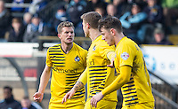 Lee Mansell (left) of Bristol Rovers has words with teammates  during the Sky Bet League 2 match between Wycombe Wanderers and Bristol Rovers at Adams Park, High Wycombe, England on 27 February 2016. Photo by Andy Rowland.