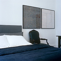 Detail of the masculine black, white and grey bedrooom of a minimalist New York apartment