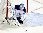 10 April 2010: Toronto Maple Leafs' goaltender Jean-Sebastien Giguere makes a third period save against the Montreal Canadiens at the Bell Centre in Montreal, Quebec, Canada. The Maple Leafs defeated the Canadiens 4-3 in sudden death overtime. Mandatory Credit: Ed Wolfstein Photo