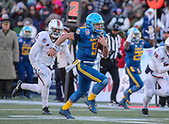 Annapolis, MD - December 28, 2017: Navy Midshipmen quarterback Zach Abey (9) runs the ball during the game between Virginia and Navy at  Navy-Marine Corps Memorial Stadium in Annapolis, MD.   (Photo by Elliott Brown/Media Images International)