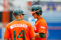 May 31, 2009:  NCAA Division 1 Gainesville Regional:     Miami first base coach Joe Mercadante (14) talks with 1B Jason Hagerty (22) talks with during 2nd round regional action at Alfred A. McKethan Stadium on the campus of University of Florida in Gainesville.  Miami Hurricanes eliminated Jacksonville 4-0 and will advance to the finals against Florida............