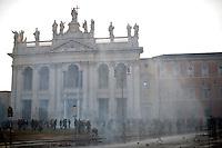 Un momento degli scontri tra black bloc e polizia in Piazza San Giovanni.<br /> Riots in Saint John square during the &quot;Occupy wall street&quot; demonstration in Rome