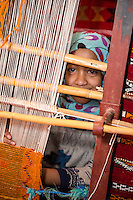 Morocco.  Young Amazigh Berber Girl Working at a Loom.  Ait Benhaddou Ksar, a World Heritage Site.