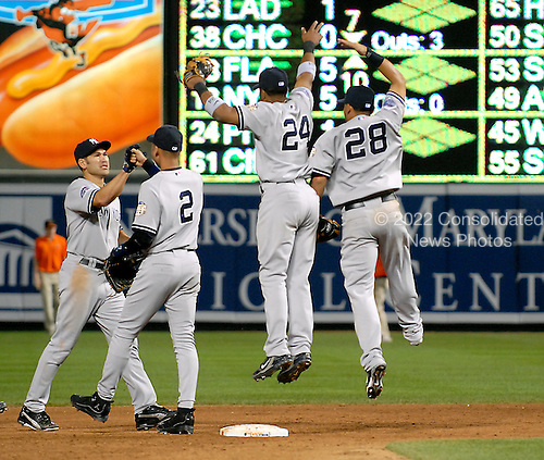 Baltimore, MD - May 28, 2008 -- New York Yankees celebrate their  4 - 2 victory over the Baltimore Orioles at Oriole Park at Camden Yards in Baltimore, MD on Wednesday , May 28, 2008. From left to right: left fielder Johnny Damon (18); shortstop Derek Jeter (2); second baseman Robinson Cano (24); and center fielder Melky Cabrera (28)..Credit: Ron Sachs / CNP.(RESTRICTION: NO New York or New Jersey Newspapers or newspapers within a 75 mile radius of New York City)