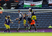 Pictured: Jonas Olsson (C) and Gareth McAuley (2nd R) of West Brom fails to score with a header, they are challenged by Ben Davies and Wilfried Bony of Swansea. Sunday 01 September 2013<br />