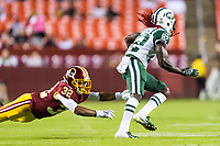 Landover, MD - August 16, 2018: Washington Redskins defensive back Ranthony Texada (32) dives and misses New York Jets wide receiver Lucky Whitehead (82) on a punt return during preseason game between the New York Jets and Washington Redskins at FedEx Field in Landover, MD. (Photo by Phillip Peters/Media Images International)