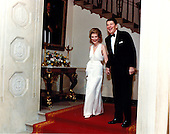 United States President Ronald Reagan and first lady Nancy Reagan arrive in the Cross Hall of the White House in Washington, D.C. on Friday, February 6, 1981 for the President's 70th birthday party.<br /> Mandatory Credit: Mary Ann Fackelman - White House via CNP