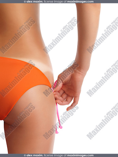 Closeup of a woman with sun tanned body showing her bikini tan lines. Suntan. Sun tanning. Isolated on white background.
