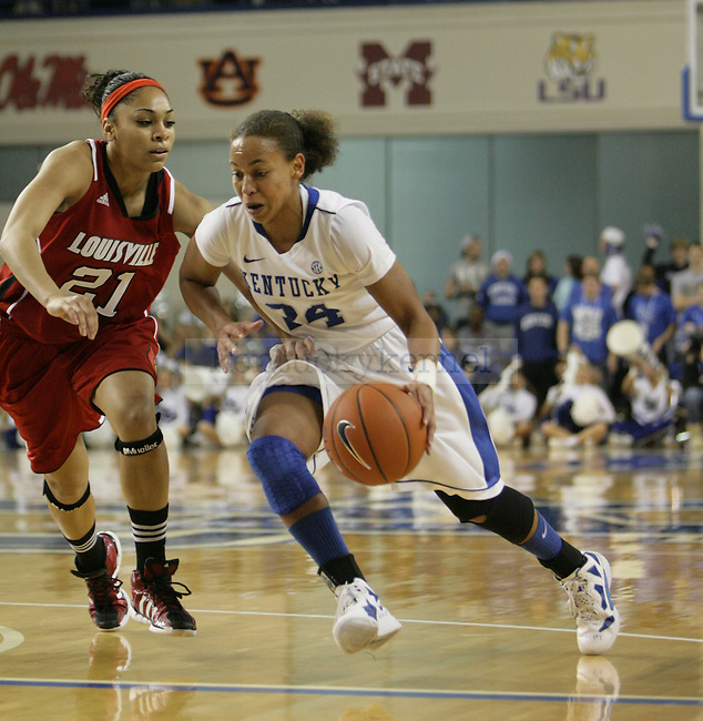 Senior Amber Smith dribbles to the lane during the first half of UK Hoop's home game against Louisville at Memorial Coliseum in Lexington, Ky., Dec. 4, 2011. Photo by Brandon Goodwin