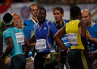 Justin Gatlin ( L) celebrates after  the 100m event at the Golden Gala IAAF Diamond League  at the Olympic stadium in Rome