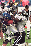 Jacksonville Jaguars running back James Stewart (33) gets hung up by Baltimore Ravens Ralph Staten (41) during second half action at lltel Stadium in Jacksonville, Fla., Sunday, Nov. 30, 1997.(Brian Myrick)..PHOTO 3 CITY ......Camera:   NC2000G         .Serial #:   4153288.Width:    1268.Height:   1012.Date:   11/30/97.Time:   15:38:20.Counter:    [52].ISO:        500 .Aperture:   F5.6.Shutter:    640 .Lens (mm):  300 .Exposure:   S   .Program:    HF  .Exp Comp:    0.0.Meter area: Cntr.Flash sync: Norm.Drive mode: H   .Focus mode: C   .Focus area: Wide.Distance:   ??  .