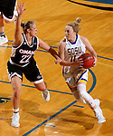 BROOKINGS, SD - JANUARY 7:  Madison Guebert #11 from South Dakota State looks to make a move past Mikaela Shaw #22 from the University of Nebraska Omaha during their game Saturday afternoon at Frost Arena in Brookings. (Dave Eggen/Inertia)