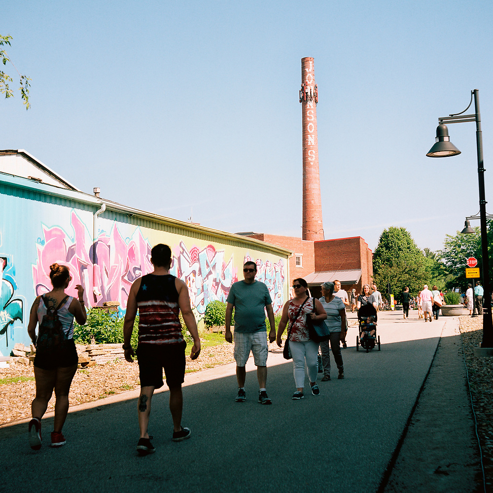 People walk the B-Line Trail near the Bloomington Farmer's Market on Friday, Aug. 10, 2018. (Photo by James Brosher)