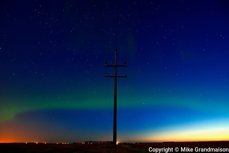 Northern lights or aurora borealis and hydro pole on prairie<br /> Dugald<br /> Manitoba<br /> Canada
