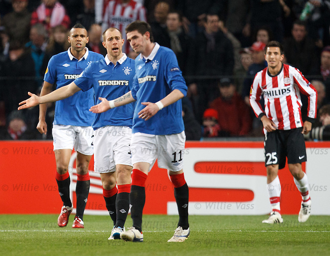 Kyle Bartley yells at Steven Whittaker who yells as Kyle Lafferty as Manolev looks on in the background