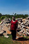 Mary Willis stands in front of rubble near where her home in Vaughn, Georgia stood after a tornado tore apart the community. As the tornado raged through the rural area, Mary covered two children to keep the winds from pulling them away. Months later, the community is still picking up the pieces and Mary's home is being rebuilt from the ground up.