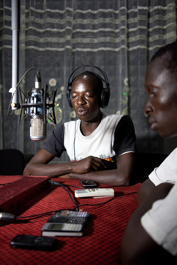 January 13, 2011 - Juba, South Sudan - South Sudanese journalists talk during a radio program at Bakhita FM radio station, a community-based radio station run by the Catholic Church in Juba. Photo credit: Benedicte Desrus