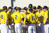 Michigan Wolverines baseball team meets before the NCAA season opening baseball game against the Texas State Bobcats on February 14, 2014 at Bobcat Ballpark in San Marcos, Texas. Texas State defeated Michigan 8-7 in 10 innings. (Andrew Woolley/Four Seam Images)