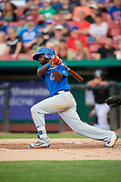 South Bend Cubs second baseman Delvin Zinn (20) follows through on a swing during a game against the Kane County Cougars on July 21, 2018 at Northwestern Medicine Field in Geneva, Illinois.  South Bend defeated Kane County 4-2.  (Mike Janes/Four Seam Images)