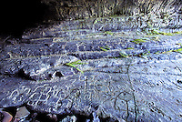 Petroglyphs inside of a lava tube at the Hawaii Volcanoes National Park