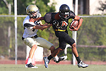 Beverly Hills, CA 09/23/11 - Jason Burr (Peninsula #26) and unknown Beverly Hills player(s) in action during the Peninsula-Beverly Hills frosh football game at Beverly Hills High School.