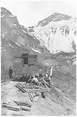 A group of workmen is re-railing D&amp;RG box car #3279 at MP 47 on the RGS Telluride Branch just east of Pandora.<br /> RGS  Pandora, CO  ca. 1920