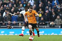 Diogo Jota of Wolverhampton Wanderers and Serge Aurier of Tottenham Hotspur during Tottenham Hotspur vs Wolverhampton Wanderers, Premier League Football at Tottenham Hotspur Stadium on 1st March 2020