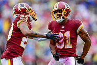 Landover, MD - September 23, 2018: Washington Redskins cornerback Quinton Dunbar (23) and cornerback Fabian Moreau (31) celebrate a strip fumble during game between the Green Bay Packers and the Washington Redskins at FedEx Field in Landover, MD. The Redskins get the win 31-17 over the visiting Packers. (Photo by Phillip Peters/Media Images International)