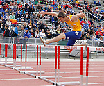 SIOUX FALLS, SD - MAY 3:  Justin Carson from South Dakota State clears a hurdle in the Men's 300 Meter Hurdle Finals Saturday at the 2014 Howard Wood Dakota Relays. (Photo by Dave Eggen/Inertia)