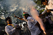 Congress party workers celebrate by burning crackers as the results are declared and their party's victory at the Indian general elections outside the All India Congress Committee office in New Delhi, India. ..India's governing Congress party was headed to a resounding victory Saturday, May 16th 2009 in the monthlong national elections.