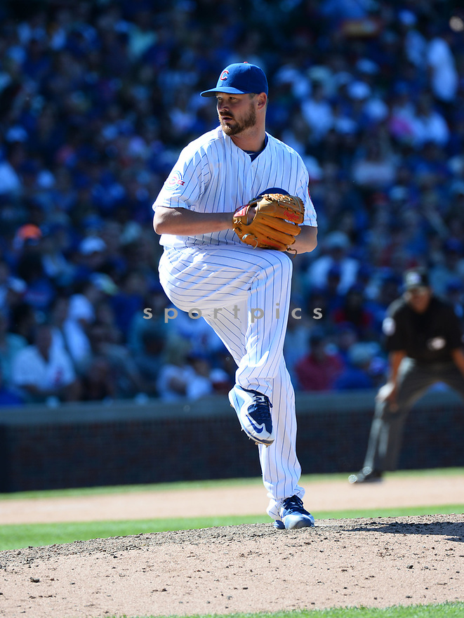 Chicago Cubs Travis Wood (37) during a game against the Pittsburgh Pirates on June 17, 2016 at Wrigley Field in Chicago, IL. The Cubs beat the Pirates 6-0.