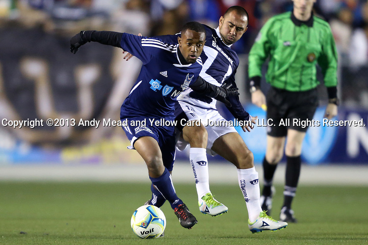 20 March 2013: Carolina's Nick Millington (GUY) (left) and UNAM's Fernando Espinosa (MEX) (right). The NASL Carolina RailHawks played LigaMX's Pumas de la UNAM at WakeMed Stadium in Cary, North Carolina in an international club friendly soccer game.