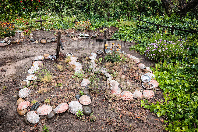 Abalone shells line the graves of unknown Native Americans in the cemetery of Carmel Mission<br /> <br /> Mission San Carlos Borromeo de Carmelo was established June 3, 1770 by Fr. Junipero Serra, second of the Alta California Missions.