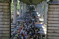 Crowds of people shopping at Marché Barbès in Goutte d'Or, 18th arrondissement, Paris, France.