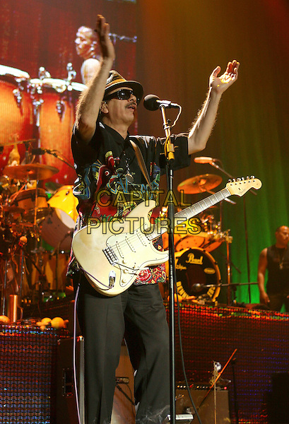 SANTANA.Performs in concert at Madison Square Garden in New York City..June 15th, 2005.stage live concert music gig performance full length guitar hat sunglasses shades clapping gesture.www.capitalpictures.com.sales@capitalpictures.com.©Capital Pictures