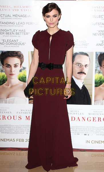 Keira Knightley.Gala Premiere of 'A Dangerous Method' at the Mayfair Hotel, London, England..January 31st 2012.full length maxi dress black belt clutch bag maroon burgundy  .CAP/ROS.©Steve Ross/Capital Pictures