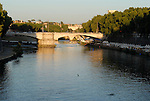 View towards the Palatine Hill over the Tiber and the Ponte Garibaldi which connects the Regola and Trastevere districts of Rome.