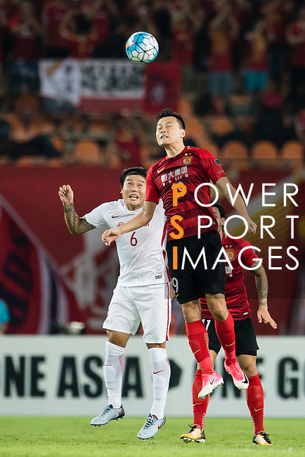Guangzhou Forward Gao Lin (R) heads the ball during the AFC Champions League 2017 Quarter-Finals match between Guangzhou Evergrande (CHN) vs Shanghai SIPG (CHN) at the Tianhe Stadium on 12 September 2017 in Guangzhou, China. Photo by Marcio Rodrigo Machado / Power Sport Images