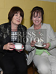 Patricia Cooper and Anne Moonan enjoy a cup of tea after Fr Sean Dooley's 25th anniversary mass at the Church of Our Lady of the Assumption Tullyallen. Photo:Colin Bell/pressphotos.ie