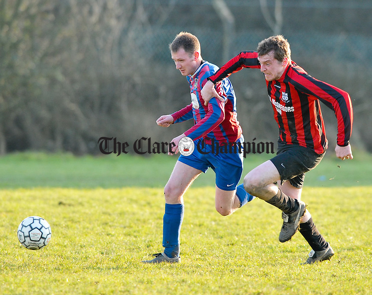 Jimmy Houlihan of Shannon Olympic A in action against  Dominic Murphy of Bridge United B during their game in Shannon. Photograph by John Kelly.