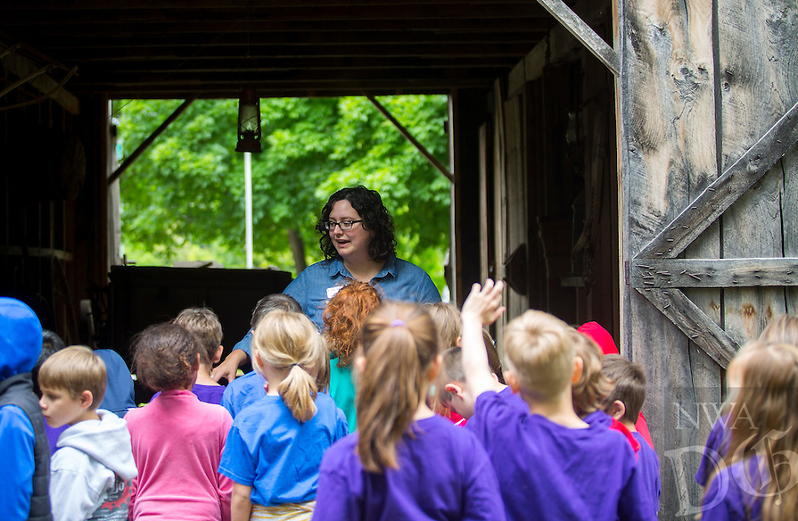 NWA Democrat-Gazette/JASON IVESTER<br /> Carly Squyres (cq), education assistant, talks to Elm Tree Elementary first-graders on Thursday, May 19, 2016, outside the barn at the Shiloh Museum of Ozark History in Springdale. The five first-grade classes from the Bentonville school visited the museum as they begin their studies on Arkansas history.
