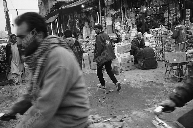 Hussein (l.) and Reza (r.) on Maiwan Avenue. Kabul, Afghanistan. March 2006