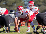 Palos Verdes, CA 10/24/14 - Michael Rubio (Redondo Union #55) and Preston Faecher (Redondo Union #4)in action during the Redondo Union - Palos Verdes Peninsula CIF Varsity football game at Peninsula High School.