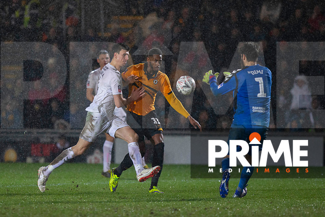 Jamille Matt of Newport County battles against Daniel Ayala of Middlesbrough during the FA Cup 4th round replay match between Newport County and Middlesbrough at Rodney Parade, Newport, Wales on 5 February 2019. Photo by Mark  Hawkins / PRiME Media Images.