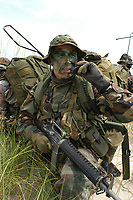 Recon Marines use MBITR digital radio (made by Thales) for voice communications MODEL-RELEASED ACTOR